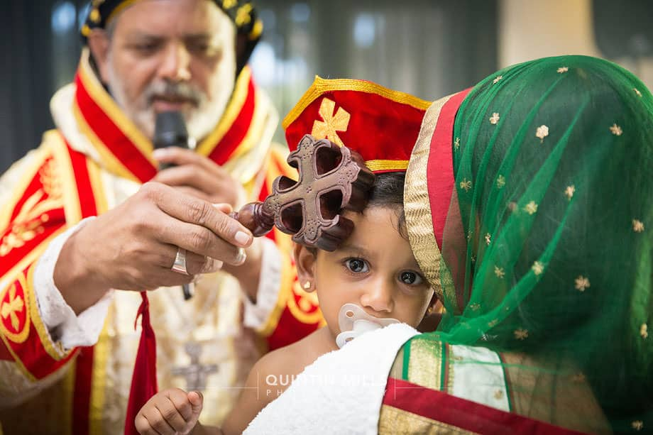 Traditional indian catholic baptism.